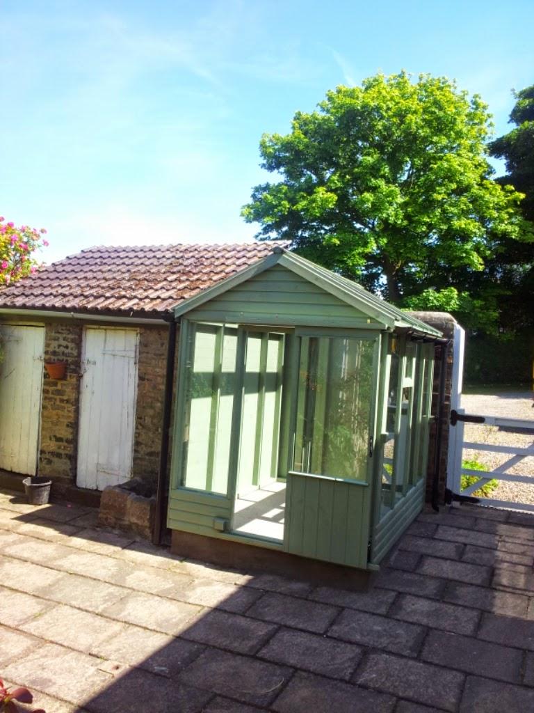 Apex timber greenhouse