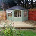 corner summerhouse with decking