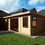Timber garden room with shiplap cladding and UPVC double doors and windows