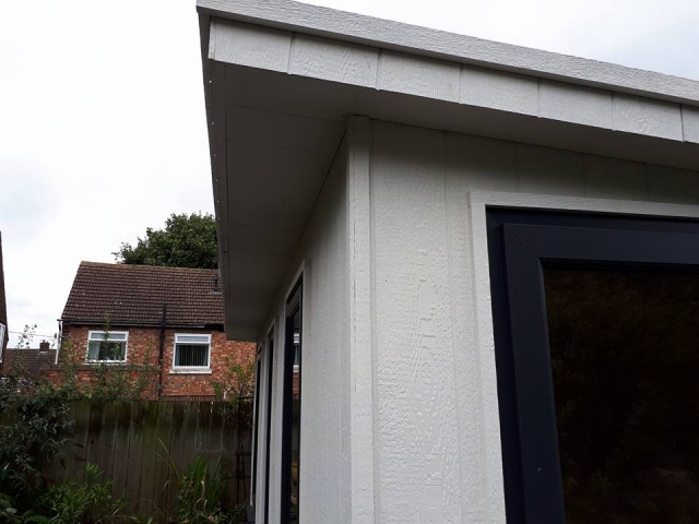 Close up of LP Strongcore Cladding finished in grey mist.