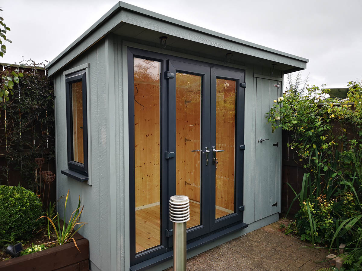 Small Summerhouse clad in Strongcore with upvc door and window